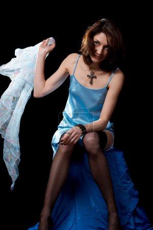 Photo pour Femme en peignoir bleu et collants isolés sur fond noir - image libre de droit