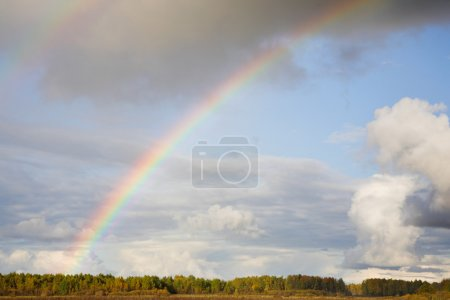 Photo for Landscape with rainbow in cloudy sky - Royalty Free Image