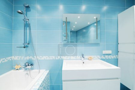 Photo for Modern luxury bathroom blue interior. No brandnames or copyright objects. - Royalty Free Image
