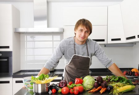 Photo for Man cooking in modern kitchen - Royalty Free Image