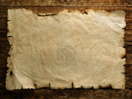 Photo for Old paper on brown wood board - Royalty Free Image