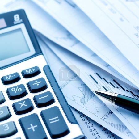 Financial concept. Calculator and pen.