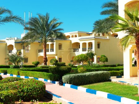 Palms and bungalow in hotel in Sharm el Sheikh, Egypt