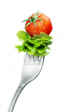 Photo for Fresh red tomato and salad on a fork. Isolated - Royalty Free Image