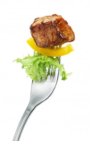 Photo for Meat and salad on a fork. Isolated - Royalty Free Image