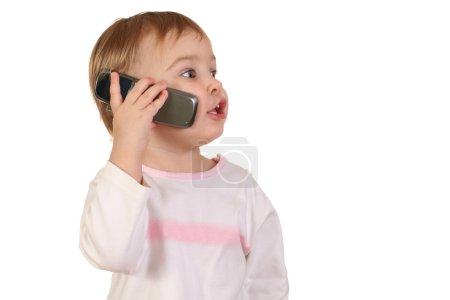 Photo pour Bébé avec téléphone - image libre de droit