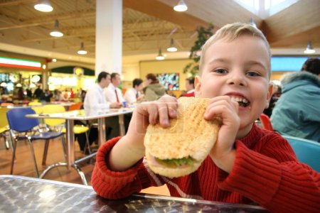 Photo for Child eat burger - Royalty Free Image
