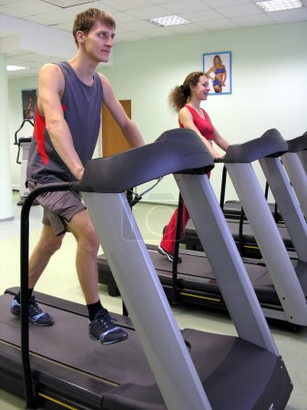 Girl and boy in health club