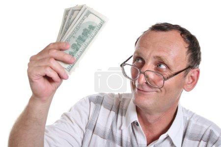 Senior with money