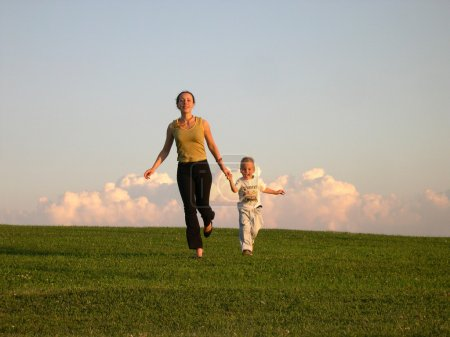 Running mother with son clouds