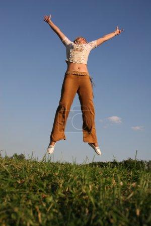 Jump girl on meadow 2