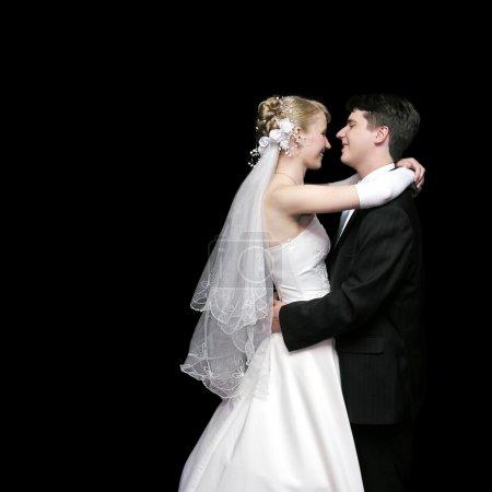 Bride and groom dancing in the dark 2