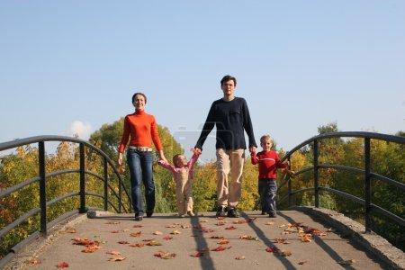 Family of four on bridge