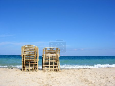 Two chairs. beach.