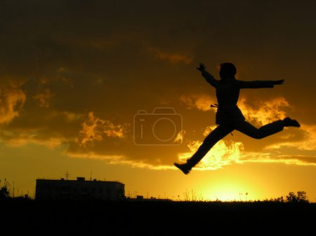 Jump girl sunset