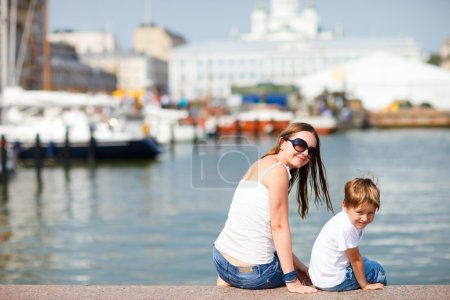 Photo for Mother and son enjoying views of city center Helsinki Finland - Royalty Free Image