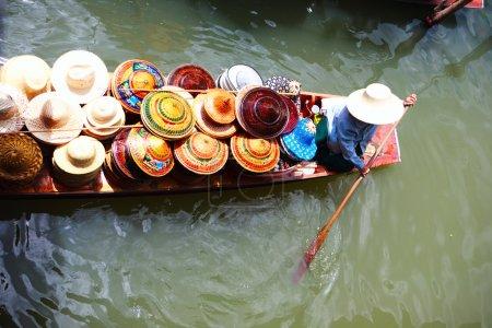 Vendor on floating market in Thailand