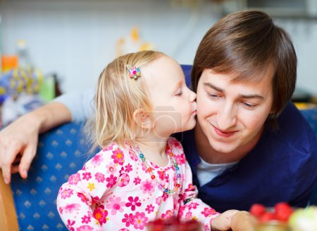 Photo for Portrait of adorable little girl kissing her father - Royalty Free Image