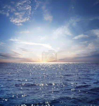 Photo for Rising sun on the horizon, blue sea, ocean - Royalty Free Image