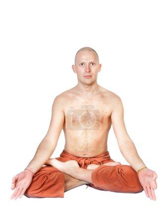 Man sitting in lotus pose