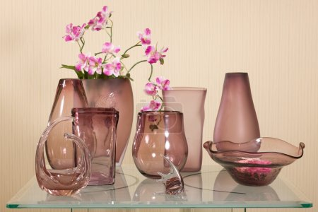 Set of vases on glass table
