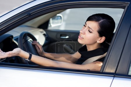 Photo for Woman driver is angry stucking in traffic jam - Royalty Free Image