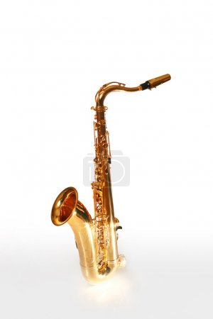 Saxophone on the white background