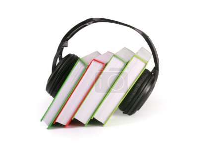 Headphones and books (audio book concept