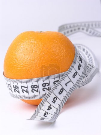 Orange embraced by a measuring tape