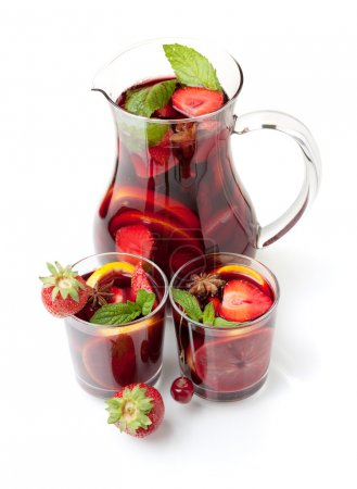 Refreshing fruit sangria in jug and two glasses