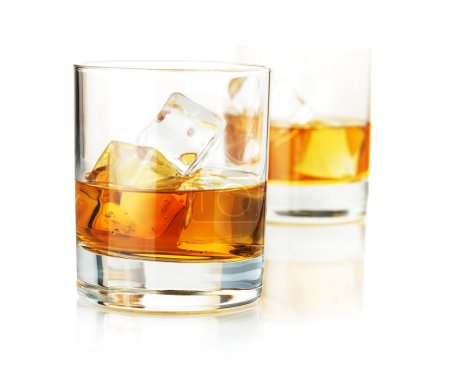 Photo for Two whiskey glasses. Isolated on white with reflection - Royalty Free Image