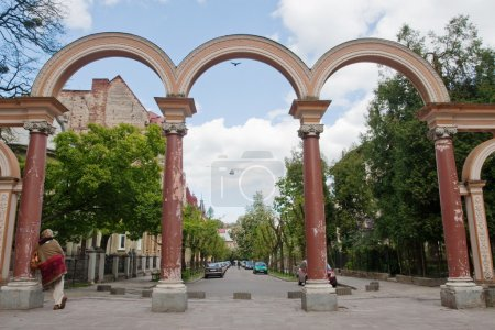 Arch on a green city street
