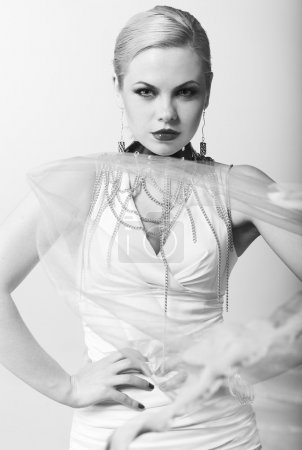 Fashion model with trendy hairstyle. B&W photo....