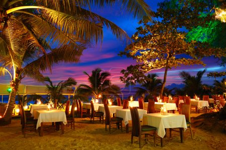 Outdoor restaurant at the beach during sunset, Phuket, Thailand