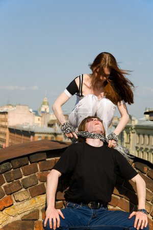 Young woman strangling a young man on a petersburg...