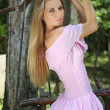 Girl in pink dress on the swing...