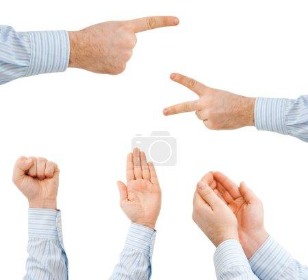 Photo pour La main de l'homme d'affaires montrant divers signes - image libre de droit