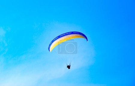 Parachute against the pure blue sky