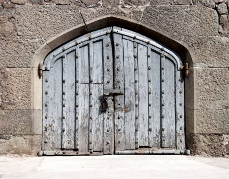 Heavy wooden gate in an ancient palace