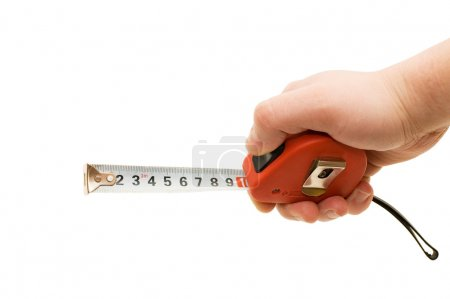 Measuring tape in a man hand