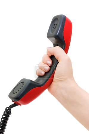 Telephone receiver in hand isolated