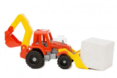 Toy tractor and the block isolated