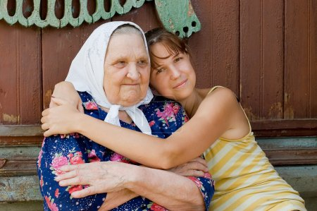 Grandmother and granddaughter embraced and happy...