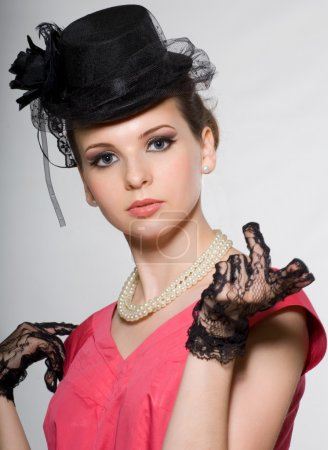Photo for Portrait of a lady in a hat with beads and lace gloves. Retro - Royalty Free Image