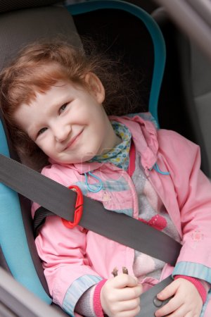 Cute little girl in a baby car seat