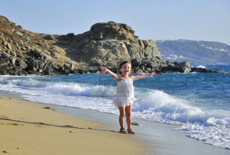 The girl is happy about sea waves