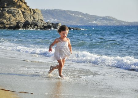 Child running through the waves