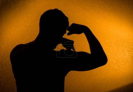 Strength and health. Silhouette of man