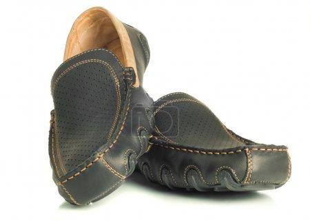 Modern footwear. Black mens shoes moccasins over w...