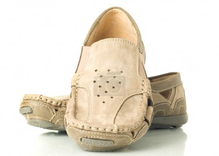 Pair of modern beige mens shoes moccasins over whi...